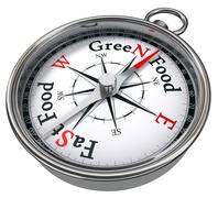 green food versus fast food concept compass - stock photo