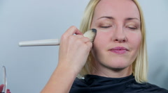 Make up done by professional with brash  Stock Footage