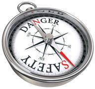 Danger vs safety concept compass Stock Photos