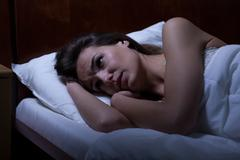 Stock Photo of Woman can't sleep during night