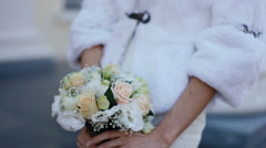 Young woman hold bouquet in her hands - stock footage