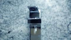 Modern bathroom chrome faucet with dripping water - stock footage