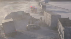 Deadly car truck accident on highway in snowstorm and blizzard Stock Footage