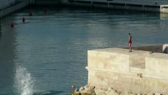 Swimmer jumping in Marseille Vieux-Port in front of MuCem Stock Footage