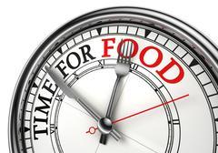 time for food concept clock closeup - stock photo