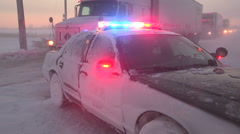 Police officers direct traffic in massive blizzard and lake effect snow storm Stock Footage