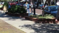 Three Women walking down a sidewalk - stock footage