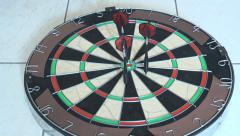 Darts being thrown into dart board Stock Footage