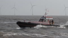 Tracking shot of Caister Offshore Lifeboat in choppy water Stock Footage