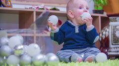 Christmas decorations is in a boys mouth Stock Footage