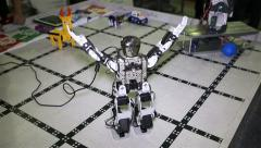 A small robot android bowing and waving his arms. Stock Footage