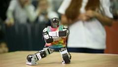 A small robot android dances Stock Footage