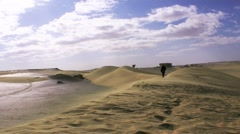 Wide desert view 1 person walk Stock Footage