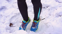 Jogger warming up on the snow, steadycam shot, slow motion shot at 240fps Stock Footage