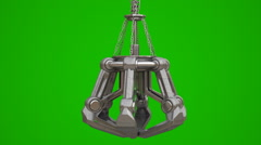 Metal mechanical crane hand on chain isolated on green Stock Footage