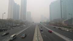 Cars driving on a heavy hazy day in Beijing CBD Stock Footage