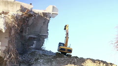 Excavator working on the destruction of building - stock footage