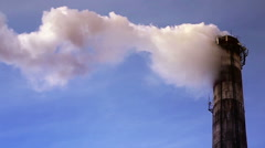 Chimney smoke in the background of blue sky - stock footage