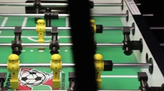 Stock Video Footage of Guys playing Foosball Table soccer at a sports bar