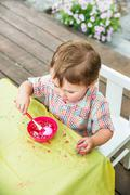 Little Boy Dyes his Easter Egg Pink Stock Photos