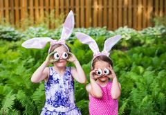 Girls Wearing Bunny Ears and Silly Egg Eyes - Close Up Stock Photos