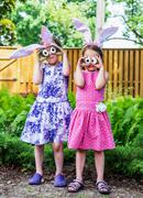 Girls Wearing Bunny Ears and Silly Egg Eyes Stock Photos