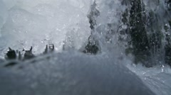 Waterfall with icicles crashed spectacular in super slow motion Stock Footage
