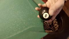 Man takes out 8 ball from corner pocket, 4K Stock Footage