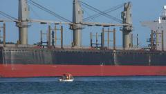 Large ship passes small boat Stock Footage
