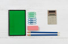 Organized supplies for work or school on white desktop Stock Photos