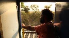 Rear view of Male model in the train Stock Footage
