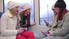 Group Of Multi-Ethnic Teens Ride Train, They All Use Smartphones Stock Footage