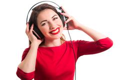 Girl in long-sleeve t-shirt wearing red lipstick touching big headphones list Stock Photos
