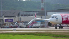 AirAsia Airbus 320 taxiing before take-off Stock Footage