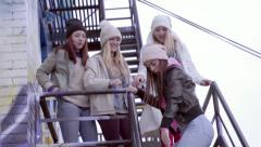 Group Of Teens Dance To A Song On A Smartphone On A Fire Escape In A City Stock Footage