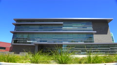 Establishing shot of the exterior of a generic modern office building. Stock Footage