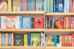 Bookshelf In Library With Children Books Stock Photos