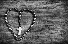 Simple Cross Inside Heart Shape - black and white Stock Photos