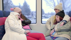 Group Of Multi-Ethnic Friends Cuddle Up Together And Sleep Peacefully On A Train Stock Footage