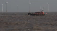 RNLI Lowestoft Lifeboat (RNLI 13-07) off Great Yarmouth Stock Footage
