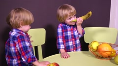 Kids twins playing with fruits Stock Footage