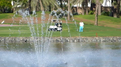 Perfect golf resort in Dubai city, fountain and lake Stock Footage