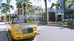 Rolls-Royce luxury car on Rodeo Drive, Beverly Hills, Los Angeles, California Stock Footage