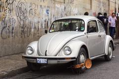 Volkswagen Beetle with Wheel Clamps in La Paz, Bolivia - stock photo