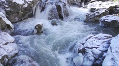 Wild river in winter in super slow motion Stock Footage