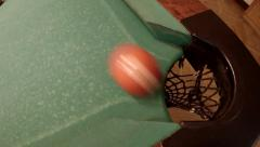 All 15 billiard balls and white ball falls in one pocket ton a green pool table Stock Footage