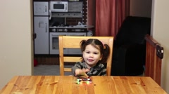 Little girl plays with a drone quadcopter Stock Footage
