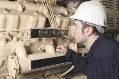 Generator  in a hospital with a repair men Stock Photos
