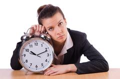 Businesswoman with clock missing her deadlines Stock Photos