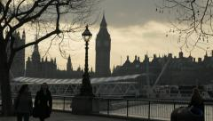 People stroll along South Bank during sunset HD - stock footage
